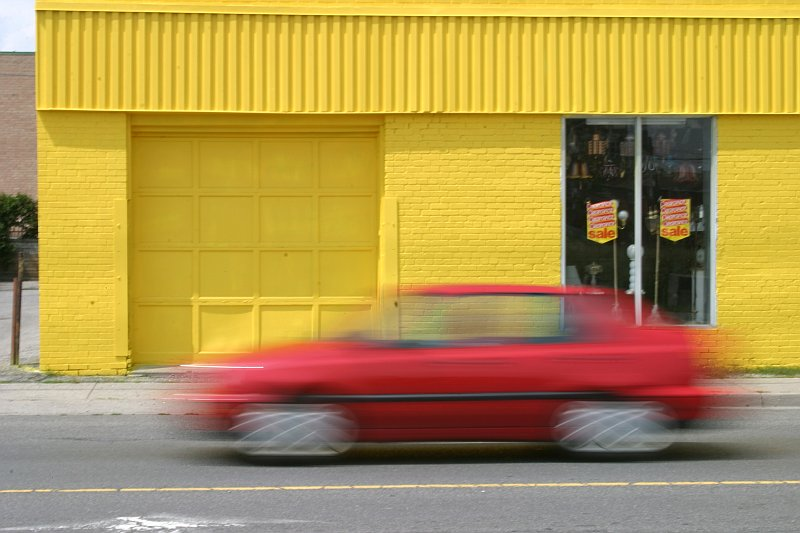 Yellow wall, red car    (click for previous picture)