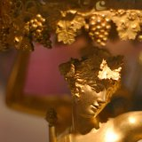 Closeup of a maenad on a gilded bronze candelabrum